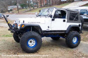 Rubicon Jeep TJ with lift, stinger bumper, rock sliders, simuilated beadlocks, etc